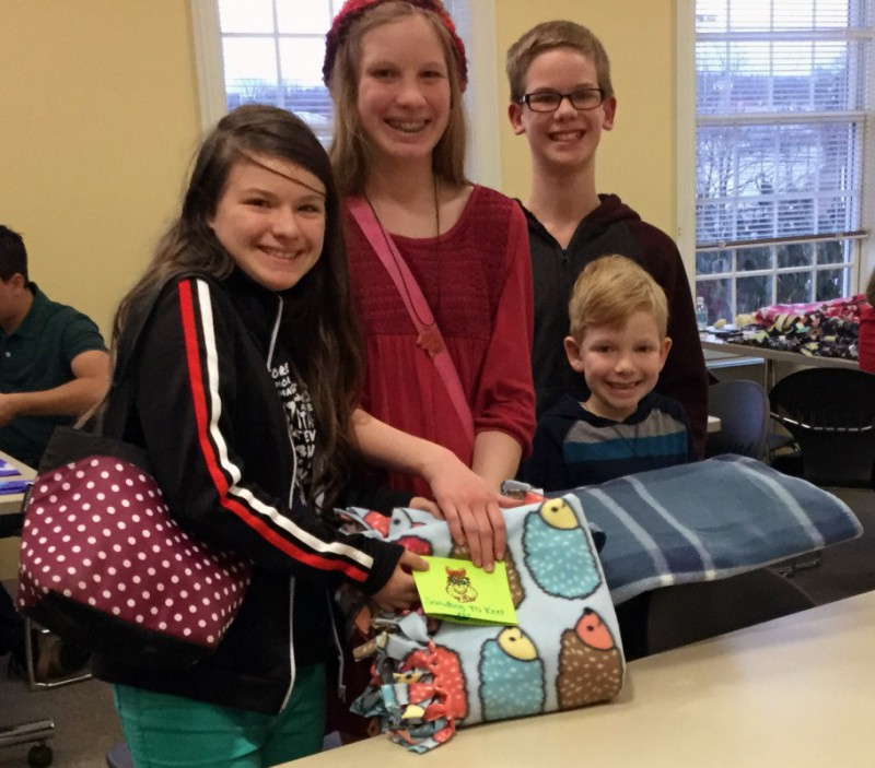 Teens with their Linus project blankets.